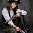 Stock Photo: Girl - pirate with two pistol in hands