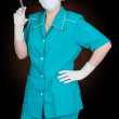 Stock Photo: Nurse with syringe in hand
