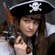 Stock Photo: Girl - pirate with pistol in hand