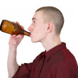 Young man with brown bottle — Stock Photo