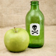 Green bottle and green apple — Stock Photo