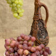 Royalty-Free Stock Photo: Ceramic bottle and grapes
