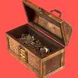 Wooden opening ancient chest with coins — Stock Photo