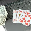 Laptop, playing cards and dollars — Stock Photo