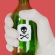 Stock Photo: Green bottle with skull and crossbones