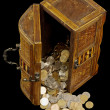 Ancient chest with coins — Stock Photo