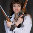 Girl - pirate with two ancient pistols — Stock Photo #2266272
