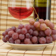 Glass bottle, goblet and grape — Stock Photo