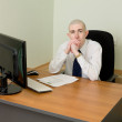 Businessman on a workplace — Stockfoto