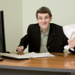 Stock Photo: Director on workplace with paper