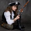 Girl - pirate with two pistol in hands - Foto Stock