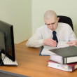 Bookkeeper on a workplace at office — Stock Photo #2267985