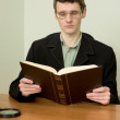 Guy in eyeglasses reads the book — Stock Photo #2267987