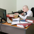 Royalty-Free Stock Photo: Clerk shoots from a rifle at the monitor