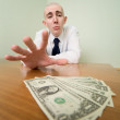 Man reaches for a batch of money — Stock Photo