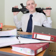 Self-satisfied worker of office armed — Stock Photo