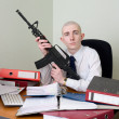 Accountant armed with a rifle — Stock Photo #2268794