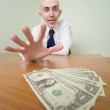 Man reaches for a batch of money — Foto Stock
