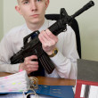 Accountant armed with a rifle — Stock Photo #2269326