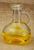 Carafe with yellow oil — Stock Photo