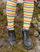 Amusing striped feet in boots — Stock Photo