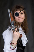 Girl - pirate with pistol in hand — Stock Photo