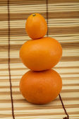 Two mandarin and kumquat — Stock Photo