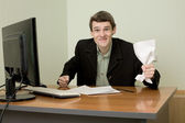 Director on a workplace with a paper — Stock Photo