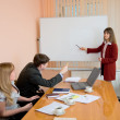 Young woman to speak at a meeting — Stock Photo #2270915