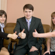 Team of businessmen show thumb up — Stock Photo #2271086