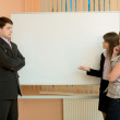 Office workers discuss work — Stock Photo