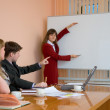 Stock Photo: Young woman to speak at a meeting