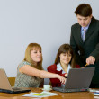 Girls at a desktop and their chief — Stock Photo #2271351