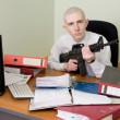 Accountant armed with a rifle — Stock Photo