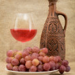 Ceramic bottle, goblet and grapes — Stock Photo
