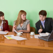 Business team sits at the table — Stock Photo