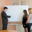 Office workers discuss work — Stock Photo #2271915