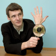 Person view a watch through a magnifier — Stock Photo