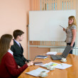 Young woman to speak at a meeting — Stock Photo
