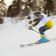 Woman rushing on skis — Stock Photo