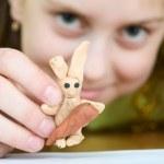Girl with a plasticine rabbit — Stock Photo
