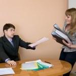 Secretary gives a folders to the chief — Stock Photo #2272556