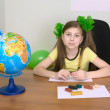 Girl sitting at a table with plasticine — Stock Photo