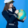 Royalty-Free Stock Photo: Woman in sea uniform and globe