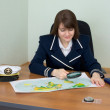 Womin uniform with geographic map — Stock Photo #2273391