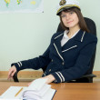 Girl in a sea uniform at a table — Foto Stock