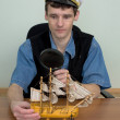 Stock Photo: Man in uniform cap with sailer