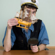 Man in uniform cap with sailer — Stock Photo