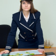 Stock Photo: Woman in uniform with geographic map