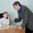 Tutor and schoolgirl with atlas — Stock Photo
